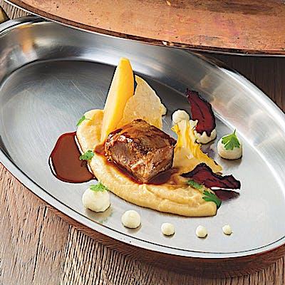 Titelbild für Backerl vom Almschwein mit Pastinakenpüree